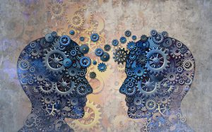 Head outlined with moving gears to show partnership and communication