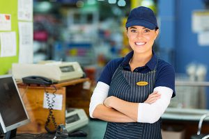 Smiling female cashier